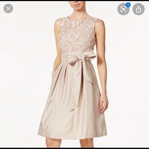 Champagne sash fit and flare formal dress